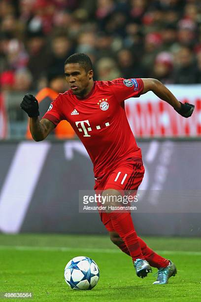 Douglas Costa of Muenchen runs with the ball during the UEFA Champions League Group F match between FC Bayern Muenchen and Olympiacos FC at Allianz...