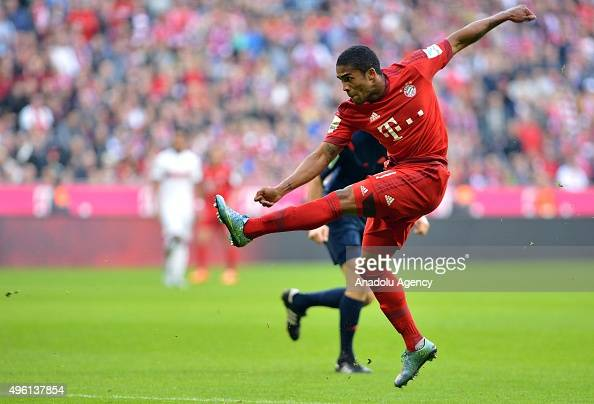 Douglas Costa of Munich shoots the goal to 20 during the Bundesliga soccer match between Bayern Munich and VfB Stuttgart at the Allianz Arena in...