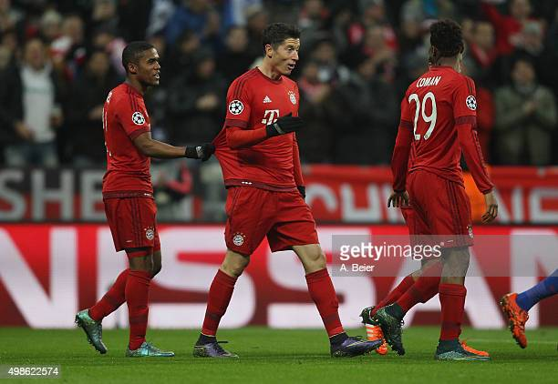 Douglas Costa Robert Lewandowski and Kingsley Coman of Bayern Muenchen celebrate Lewandowski's first goal during the Champions League group F match...