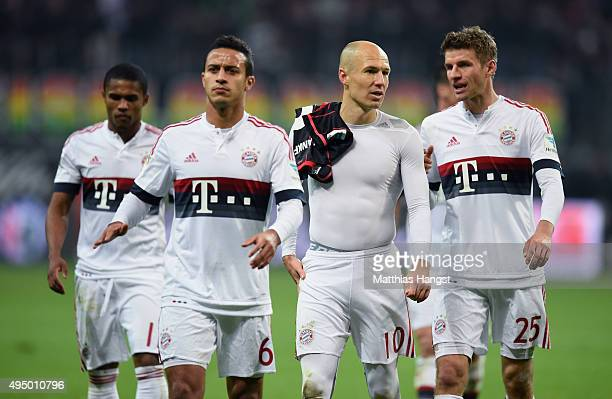 Douglas Costa Thiago Arjen Robben and Thomas Mueller of Muenchen walk off the pitch after the Bundesliga match between Eintracht Frankfurt and FC...