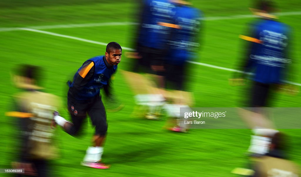 Douglas Costa warms up during a FC Shakhtar Donetsk training session ahead of their UEFA Champions League round of 16 match against Borussia Dortmund on March 4, 2013 in Dortmund, Germany.