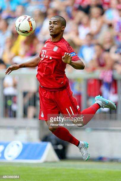Douglas Coste battles for the ball during a FC Bayern Muenchen training session after the FC Bayern Muenchen season opening and team presentation at...
