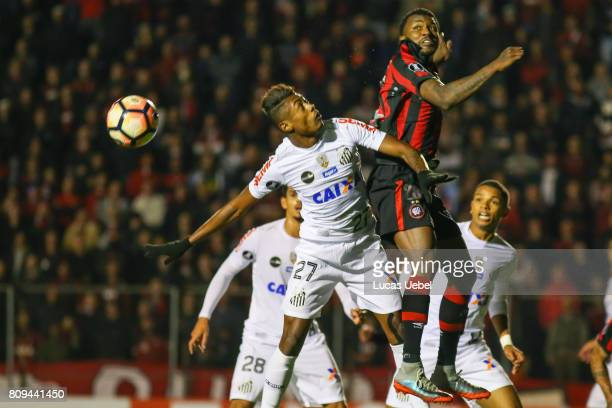 Douglas Coutinho of Atletico PR battles for the ball against Bruno Henrique of Santos during the match Atletico PR v Santos as part of Copa...