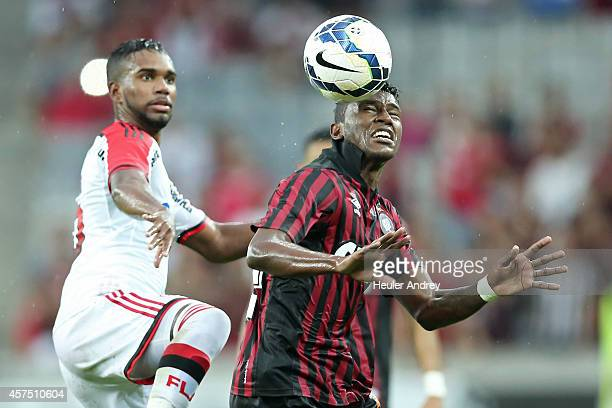 Douglas Coutinho of AtleticoPR competes for the ball with Luiz Antonio of Flamengo during the match between AtleticoPR and Flamengo for the Brazilian...