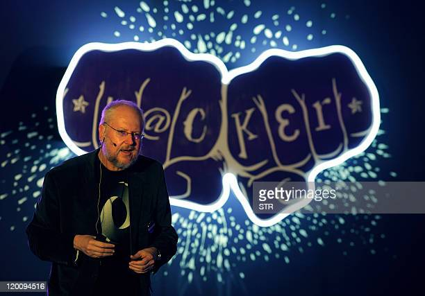 Douglas Crockford senior JavaScript architect at Yahoo speaks to a group of people during 'Open Hack India' a 24hour nonstop hacking event organised...