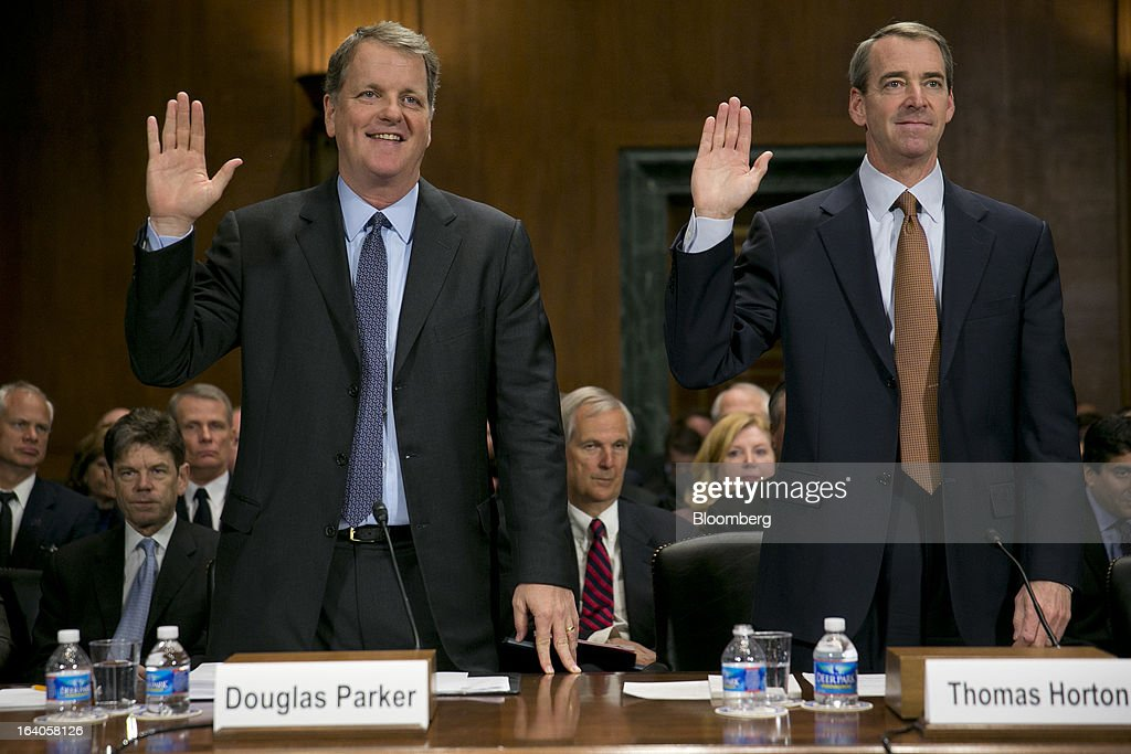 Douglas 'Doug' Parker, chairman and chief executive officer of US Airways Group Inc., left, and Thomas 'Tom' Horton, chairman, president and chief executive officer of AMR Corp.'s American Airlines, are sowrn in at a Senate Judiciary Committee hearing in Washington, D.C., U.S., on Tuesday, March 19, 2013. The proposed merger between American Airlines US Airways would increase fares, reduce service to smaller communities and make it more difficult for low-cost carriers to compete, two consumer advocates said at a Senate hearing. Photographer: Andrew Harrer/Bloomberg via Getty Images