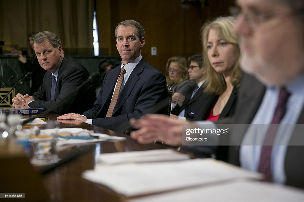 Douglas 'Doug' Parker, chairman and chief executive officer of US Airways Group Inc., left to right, Thomas 'Tom' Horton, chairman, president and chief executive officer of AMR Corp.'s American Airlines, and Diana Moss, vice president of the American Antitrust Institute, listen as William McGee, a consultant to Consumers Union, speaks during Senate Judiciary Committee hearing in Washington, D.C., U.S., on Tuesday, March 19, 2013. The proposed merger between American Airlines and US Airways would increase fares, reduce service to smaller communities and make it more difficult for low-cost carriers to compete, two consumer advocates said at a Senate hearing. Photographer: Andrew Harrer/Bloomberg via Getty Images