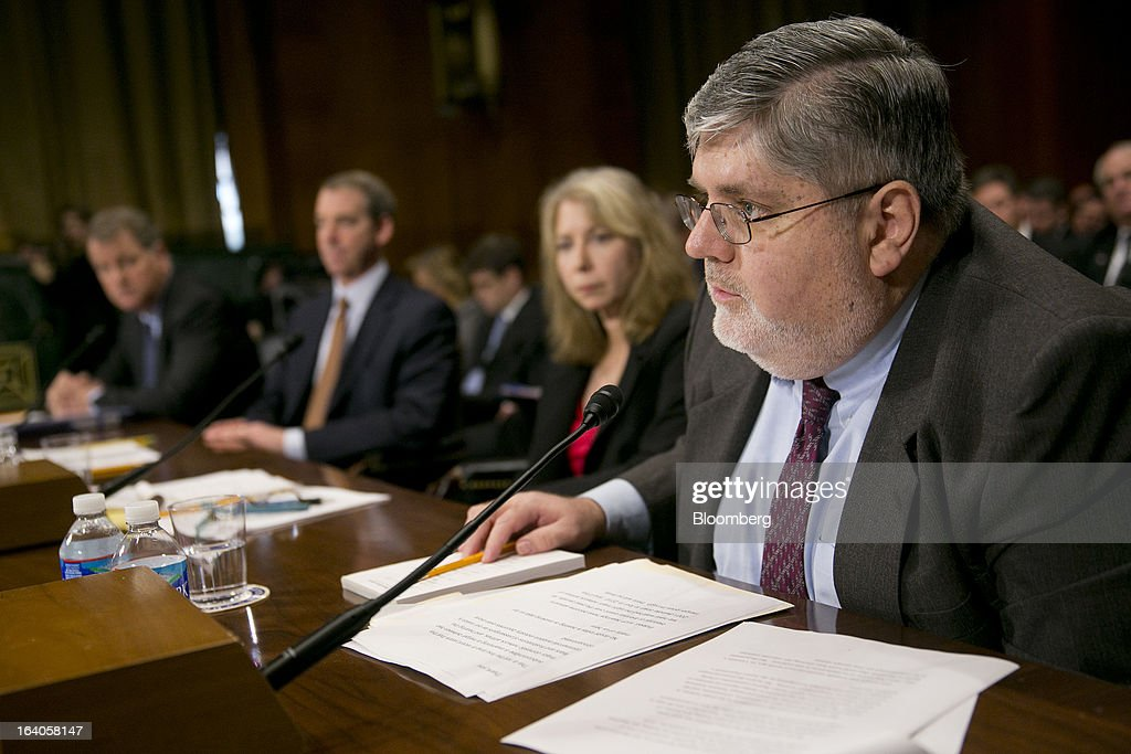 Douglas 'Doug' Parker, chairman and chief executive officer of US Airways Group Inc., left to right, Thomas 'Tom' Horton, chairman, president and chief executive officer of AMR Corp.'s American Airlines, and Diana Moss, vice president of the American Antitrust Institute, listen as William McGee, a consultant to Consumers Union, speaks during a Senate Judiciary Committee hearing in Washington, D.C., U.S., on Tuesday, March 19, 2013. The proposed merger between American Airlines and US Airways would increase fares, reduce service to smaller communities and make it more difficult for low-cost carriers to compete, two consumer advocates said at a Senate hearing. Photographer: Andrew Harrer/Bloomberg via Getty Images
