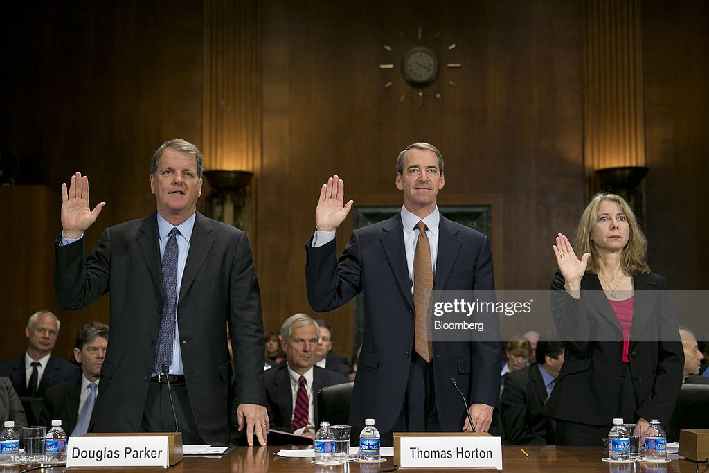 Douglas 'Doug' Parker, chairman and chief executive officer of US Airways Group Inc., left to right, Thomas 'Tom' Horton, chairman, president and chief executive officer of AMR Corp.'s American Airlines, and Diana Moss, vice president of the American Antitrust Institute, are sowrn in at a Senate Judiciary Committee hearing in Washington, D.C., U.S., on Tuesday, March 19, 2013. The proposed merger between AMR Corp.'s American Airlines and US Airways Group Inc. would increase fares, reduce service to smaller communities and make it more difficult for low-cost carriers to compete, two consumer advocates said at a Senate hearing. Photographer: Andrew Harrer/Bloomberg via Getty Images