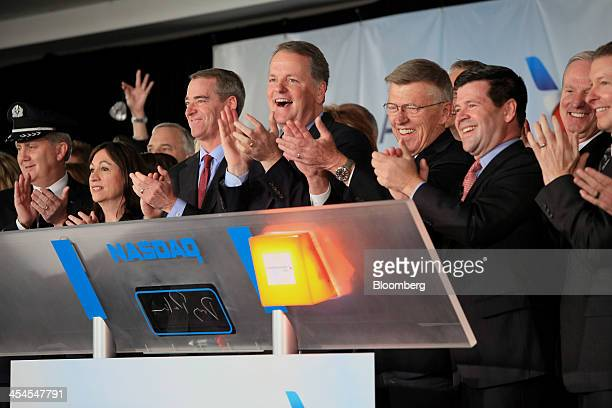 Douglas 'Doug' Parker chief executive officer of the newly formed American Airlines Group Inc center and Thomas 'Tom' Horton chairman president and...