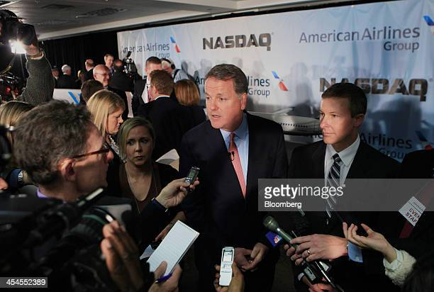 Douglas 'Doug' Parker chief executive officer of the newly formed American Airlines Group Inc center speaks to members of the media after remotely...