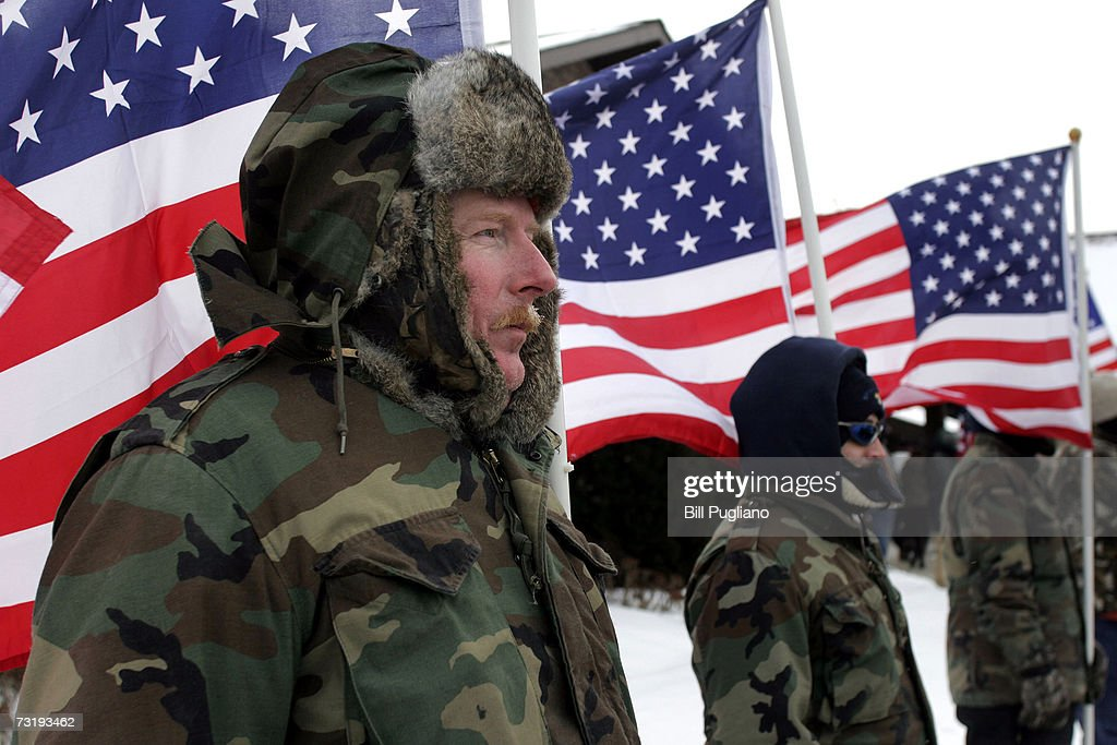 Douglas Downing of Saginaw Michigan a member of the Patriot Guard Riders stands in a belowzero windchill to honor Marine Cpl Mark D Kidd of Milford...