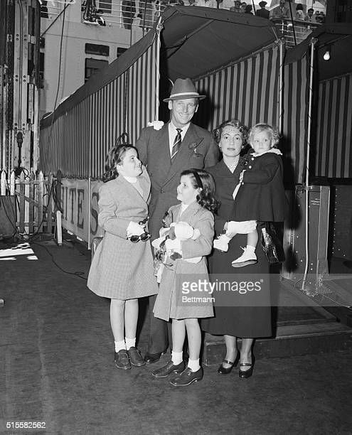 Douglas Fairbanks Jr and his family in New York on June 9 1949 waiting to board the S S Caronia steamship before sailing for a vacation in Europe...