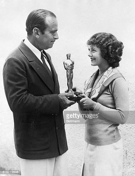 Douglas Fairbanks presents Janet Gaynor with the first Academy Award for Best Actress for her work in Seventh Heaven as well as Street Angel and...