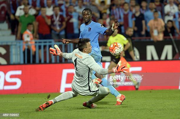 Douglas Franco of Trabzonspor is in action against Muslera of Galatasaray during a Turkish Spor Toto Super League soccer match between Trabzonspor...