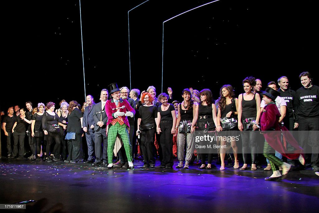 Douglas Hodge introduces 'Charlie' Jack Costello at the curtain call during the press night performance of 'Charlie And The Chocolate Factory' at the Theatre Royal Drury Lane on June 25, 2013 in London, England.