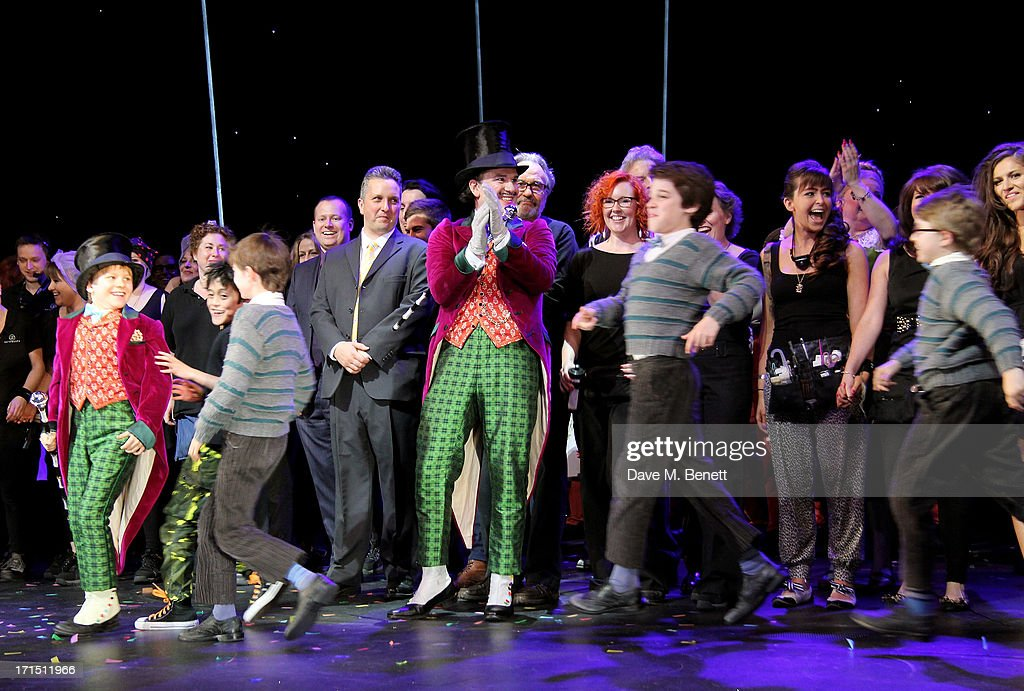 Douglas Hodge (C) introduces the Charlie's Jake Costello, Tom Klenerman, Isaac Rouse and Louis Suc as they bow at the curtain call during the press night performance of 'Charlie And The Chocolate Factory' at the Theatre Royal Drury Lane on June 25, 2013 in London, England.