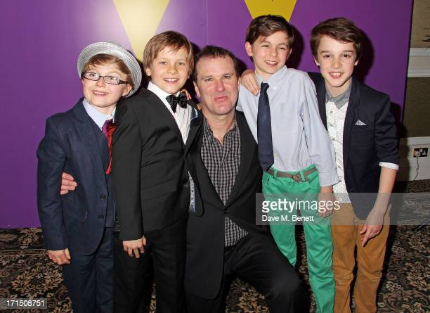 Douglas Hodge poses with Charlie actors Louis Suc Jack Costello Tom Klenerman and Isaac Rouse at an after party celebrating the press night...