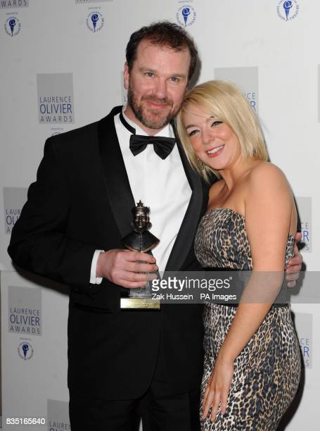Douglas Hodge wins the Best Actor in a Musical Award presented by Sheridan Smith during the Laurence Olivier Awards at the Grosvenor Hotel in central...
