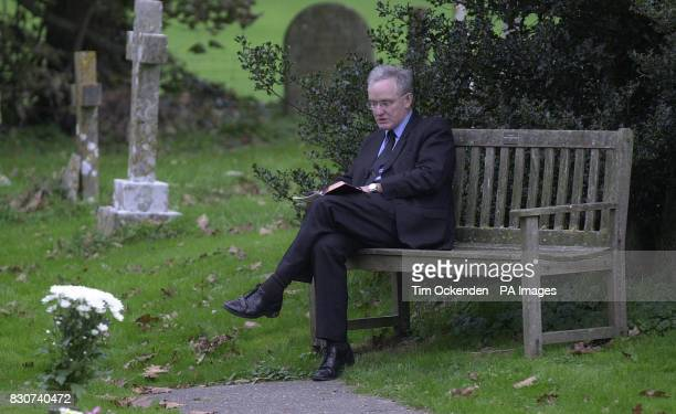 Douglas Hogg QC former agriculture minister and son of Lord Hailsham who was buried at All Saints Church Herstmonceux sits in the church grounds to...