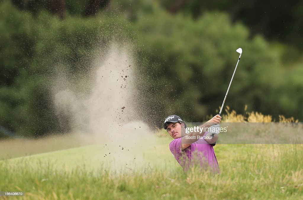 Douglas Holloway of New Zealand plays out of a bunker during day one of the Australian Masters at Kingston Heath Golf Club on November 15, 2012 in Melbourne, Australia.