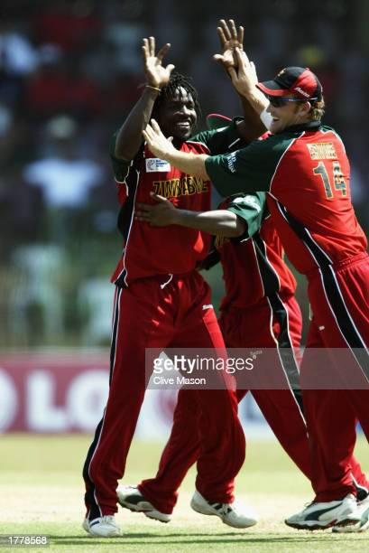 Douglas Hondo of Zimbabwe is congratulated by teammates after dismissing Sourav Ganguly of India during the ICC Champions Trophy match between India...
