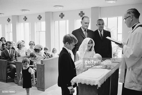 Douglas Kennedy held by his sister Kerry is Baptized in Maryland Standing at the altar is also brother David and Godparents Averill Harriman and...