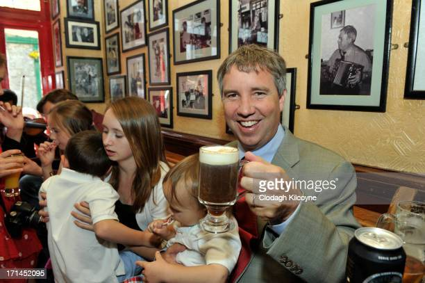 Douglas Kennedy samples Irish Coffee during a visit to Tigh Coili pub as part of commemorations for the 50th anniversary of the visit by his uncle US...