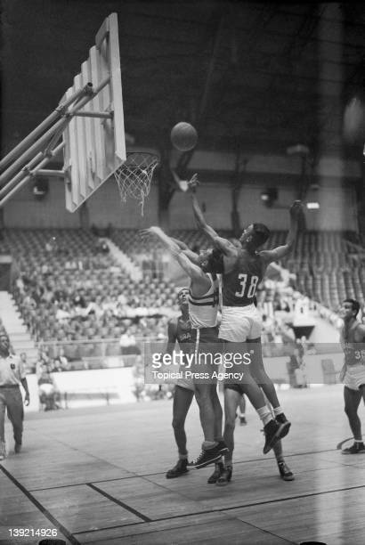 Douglas Legg of Great Britain defending against Azevedo of Brazil in a Group A basketball match at Harringay Arena during the London Olympic Games...