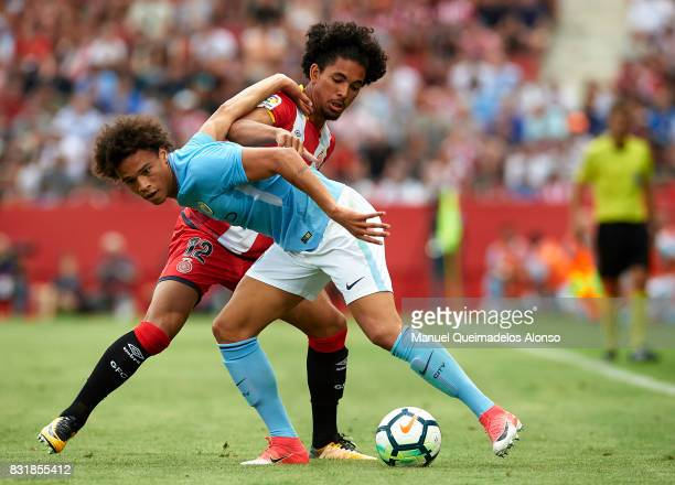 Douglas Luiz of Girona is challenged by Leroy Sane of Manchester City during the preseason friendly match between Girona and Manchester City at...