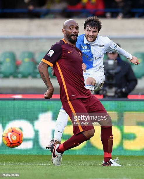 Douglas Maicon of AS Roma competes for the ball with Alessandro Gamberini of AC Chievo during the Serie A match between AC Chievo Verona and AS Roma...