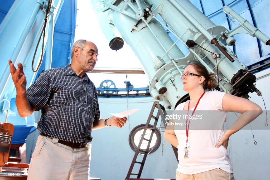 Douglas Metcalfe of the South African Astronomical Observatory (SAAO) and astronomer Dr Nicola Loaring on March 27, 2012 in Cape Town, South Africa. Metcalfe stands alongside the 115 year old restored McLean telescope. The telescope that was built in 1897 and has been restored so that visitors to the observatory can experience the way in which astronomers of the past looked at the sky.