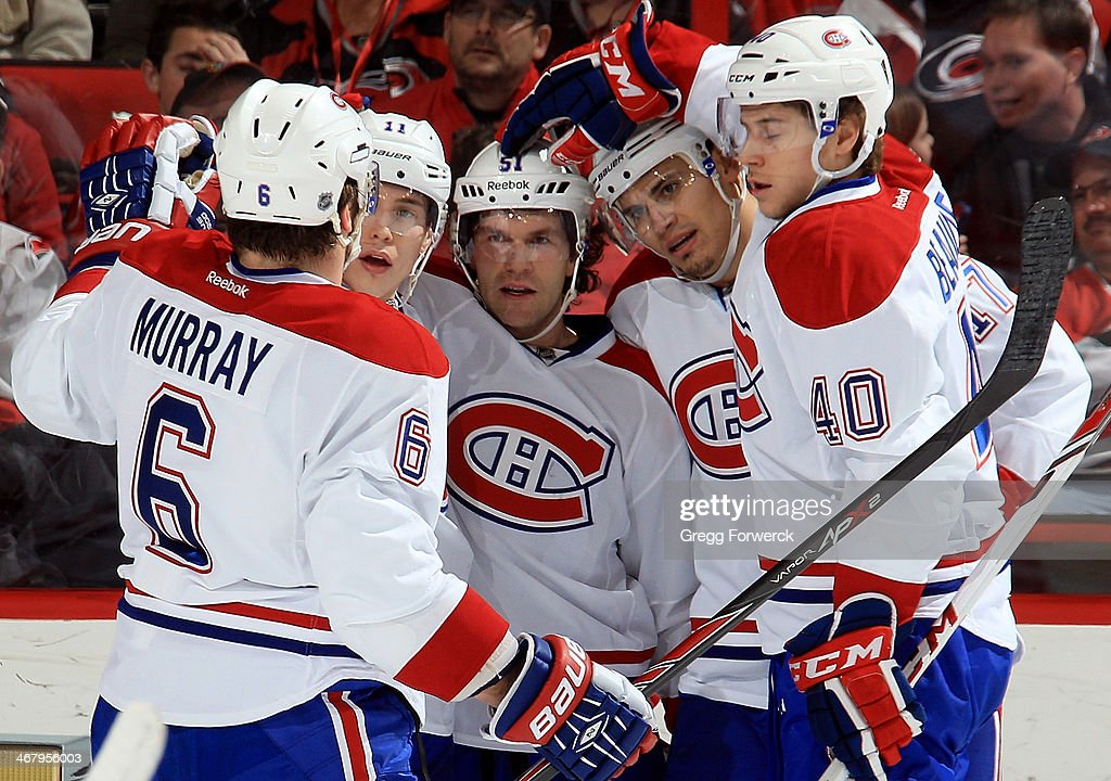 Douglas Murray #6, <a gi-track='captionPersonalityLinkClicked' href=/galleries/search?phrase=Brendan+Gallagher&family=editorial&specificpeople=3704208 ng-click='$event.stopPropagation()'>Brendan Gallagher</a> #11, <a gi-track='captionPersonalityLinkClicked' href=/galleries/search?phrase=Rene+Bourque&family=editorial&specificpeople=685715 ng-click='$event.stopPropagation()'>Rene Bourque</a> #17 and Nathan Beaulieu #40 of the Montreal Canadiens celebrate a third-period goal scored by <a gi-track='captionPersonalityLinkClicked' href=/galleries/search?phrase=David+Desharnais&family=editorial&specificpeople=4084305 ng-click='$event.stopPropagation()'>David Desharnais</a> #51 against the Carolina Hurricanes during their NHL game at PNC Arena on February 8, 2014 in Raleigh, North Carolina.