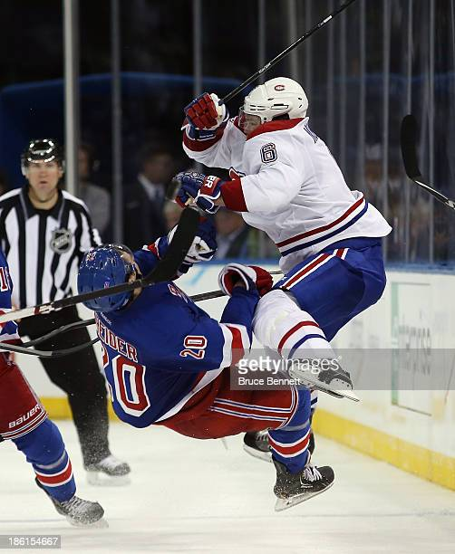 Douglas Murray of the Montreal Canadiens takes a two minute penalty for interference in the third period against Chris Kreider of the New York...