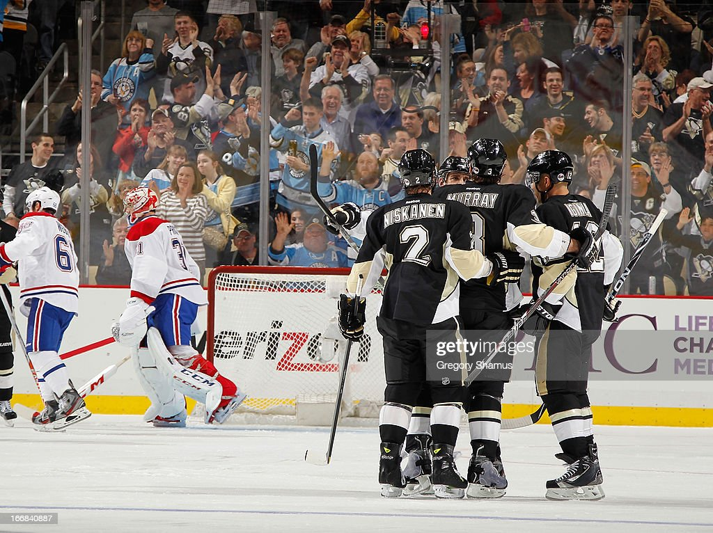 Douglas Murray #3 of the Pittsburgh Penguins celebrates his goal with <a gi-track='captionPersonalityLinkClicked' href=/galleries/search?phrase=Matt+Niskanen&family=editorial&specificpeople=2106633 ng-click='$event.stopPropagation()'>Matt Niskanen</a> #2 and <a gi-track='captionPersonalityLinkClicked' href=/galleries/search?phrase=Jarome+Iginla&family=editorial&specificpeople=201792 ng-click='$event.stopPropagation()'>Jarome Iginla</a> #12 during the third period against the Montreal Canadiens on April17, 2013 at Consol Energy Center in Pittsburgh, Pennsylvania. Pittsburgh won the game 6-4.