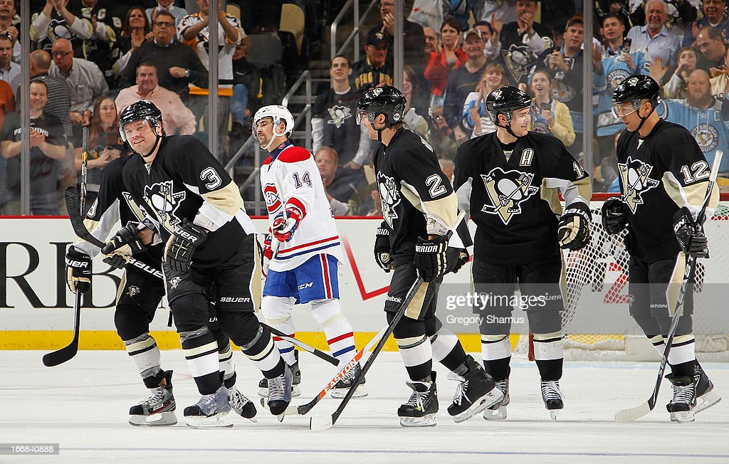Douglas Murray #3 of the Pittsburgh Penguins celebrates his goal with <a gi-track='captionPersonalityLinkClicked' href=/galleries/search?phrase=Matt+Niskanen&family=editorial&specificpeople=2106633 ng-click='$event.stopPropagation()'>Matt Niskanen</a> #2, <a gi-track='captionPersonalityLinkClicked' href=/galleries/search?phrase=Chris+Kunitz&family=editorial&specificpeople=604159 ng-click='$event.stopPropagation()'>Chris Kunitz</a> #14 and <a gi-track='captionPersonalityLinkClicked' href=/galleries/search?phrase=Jarome+Iginla&family=editorial&specificpeople=201792 ng-click='$event.stopPropagation()'>Jarome Iginla</a> #12 during the third period against the Montreal Canadiens on April17, 2013 at Consol Energy Center in Pittsburgh, Pennsylvania. Pittsburgh won the game 6-4.
