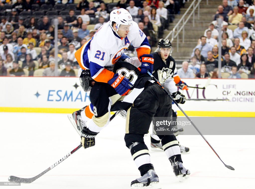 Douglas Murray #3 of the Pittsburgh Penguins defends against <a gi-track='captionPersonalityLinkClicked' href=/galleries/search?phrase=Kyle+Okposo&family=editorial&specificpeople=540469 ng-click='$event.stopPropagation()'>Kyle Okposo</a> #21 of the New York Islanders in Game One of the Eastern Conference Quarterfinals during the 2013 NHL Stanley Cup Playoffs at Consol Energy Center on May 1, 2013 in Pittsburgh, Pennsylvania. The Penguins won 5-0.