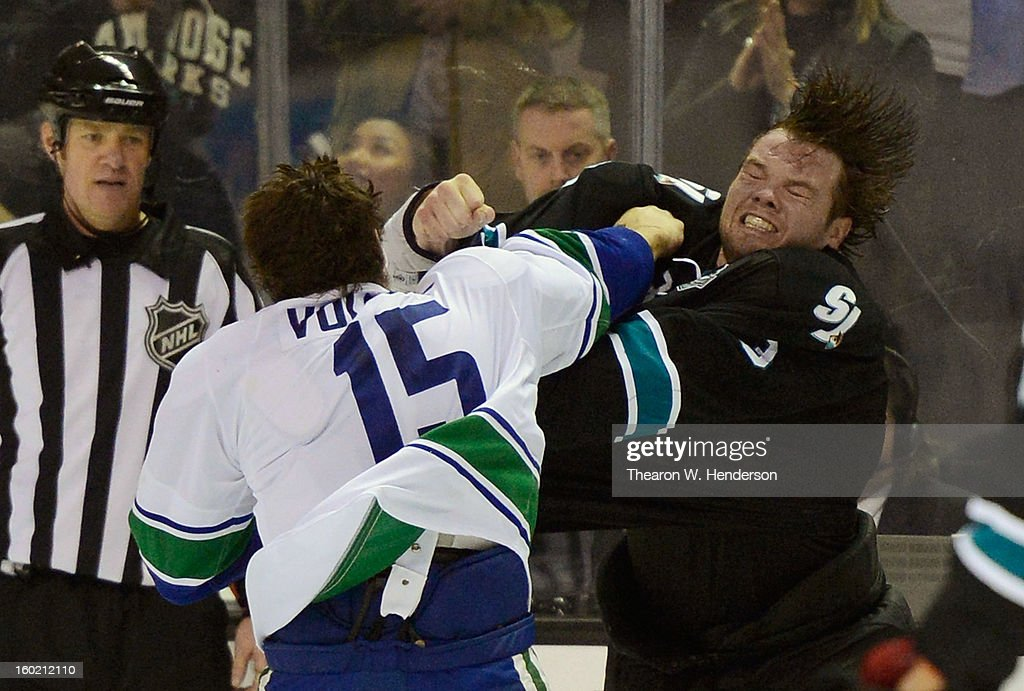 Douglas Murray #3 of the San Jose Sharks fights with <a gi-track='captionPersonalityLinkClicked' href=/galleries/search?phrase=Aaron+Volpatti&family=editorial&specificpeople=7187520 ng-click='$event.stopPropagation()'>Aaron Volpatti</a> #15 of the Vancouver Canucks in the third period of their game at HP Pavilion on January 27, 2013 in San Jose, California. The Sharks won the game 4-1.