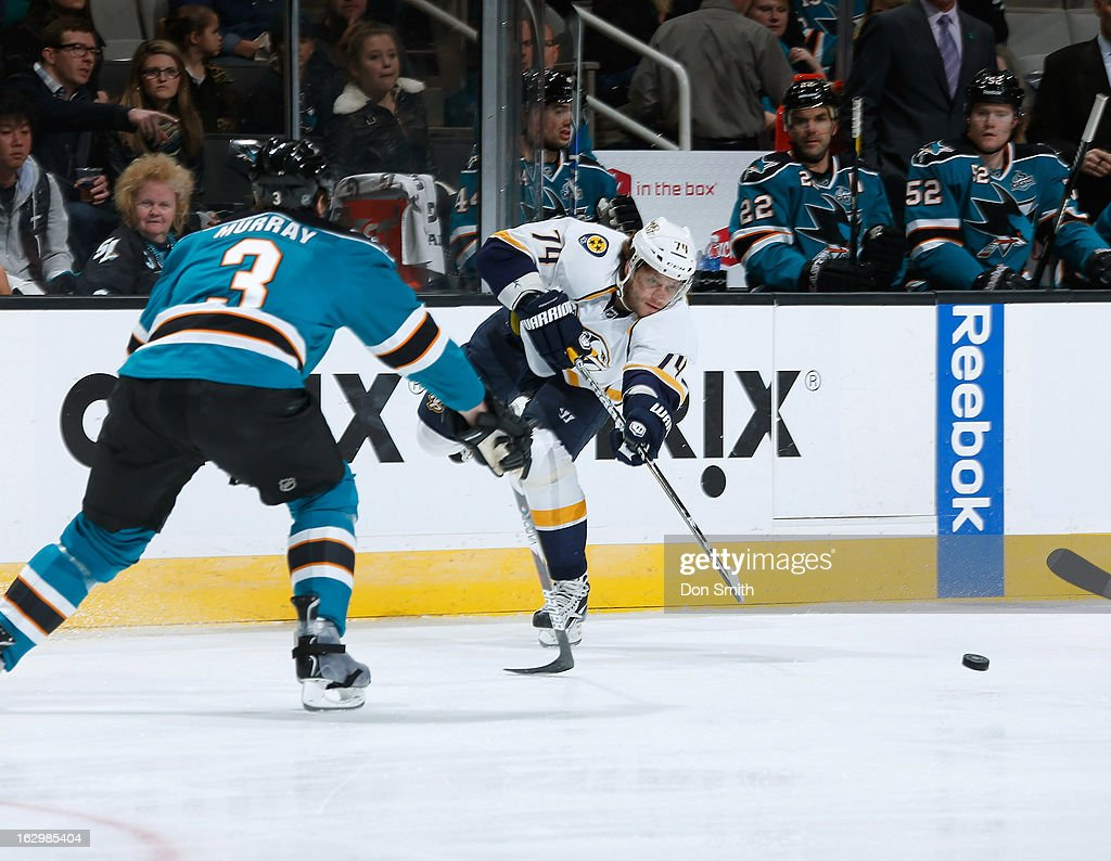 Douglas Murray #3 of the San Jose Sharks plays defense against <a gi-track='captionPersonalityLinkClicked' href=/galleries/search?phrase=Sergei+Kostitsyn&family=editorial&specificpeople=599906 ng-click='$event.stopPropagation()'>Sergei Kostitsyn</a> #74 of the Nashville Predators during an NHL game on March 2, 2013 at HP Pavilion in San Jose, California.