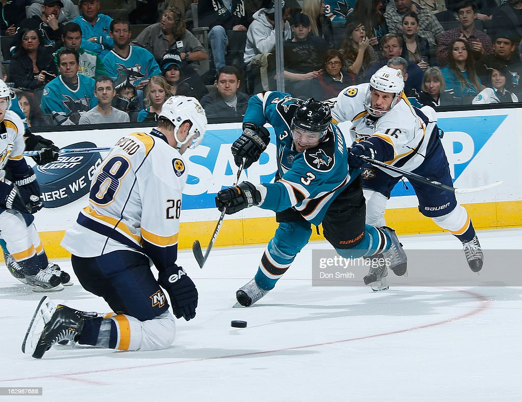 Douglas Murray #3 of the San Jose Sharks takes a shot against <a gi-track='captionPersonalityLinkClicked' href=/galleries/search?phrase=Paul+Gaustad&family=editorial&specificpeople=577980 ng-click='$event.stopPropagation()'>Paul Gaustad</a> #28 and Rich Clune #16 of the Nashville Predators during an NHL game on March 2, 2013 at HP Pavilion in San Jose, California.