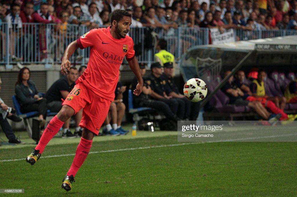 Douglas of Barcelona in action during the La Liga match between Malaga CF and FC Barcelona at La Rosaleda studium on September 24 2014 in Malaga Spain