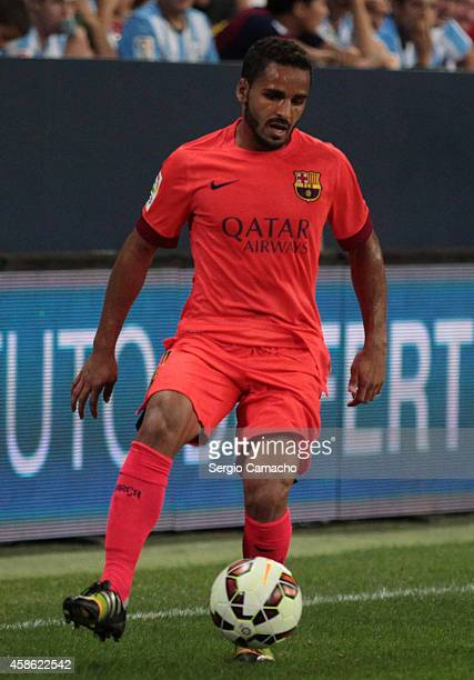 Douglas of Barcelona in action during the La Liga match between Malaga CF and FC Barcelona at La Rosaleda studium on September 24 2014 in Malaga Spain