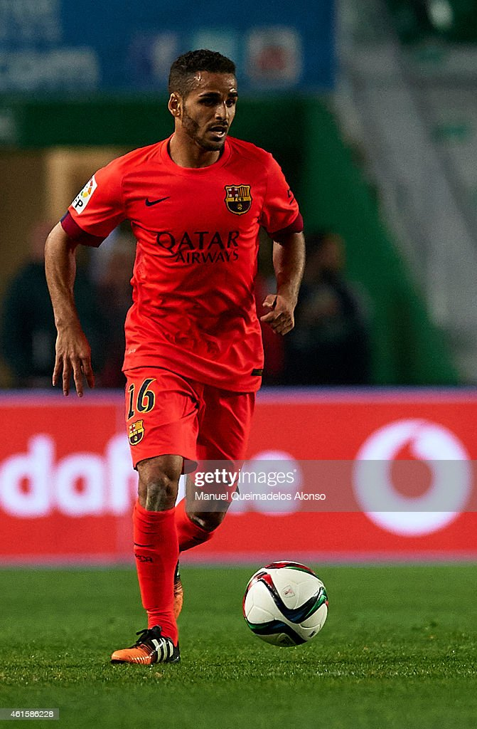 Douglas of Barcelona runs with the ball during the Copa del Rey Round of 16 Second Leg match between Elche FC and FC Barcelona at Estadio Manuel...
