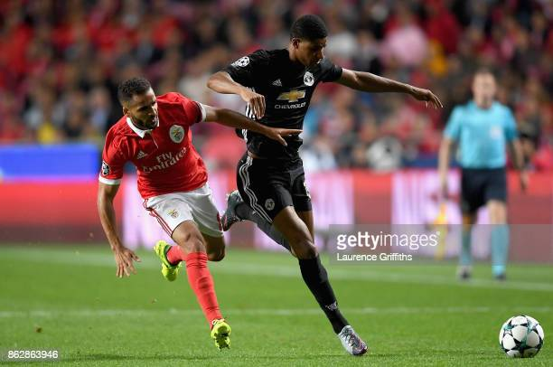 Douglas of Benfica and Marcus Rashford of Manchester United during the UEFA Champions League group A match between SL Benfica and Manchester United...