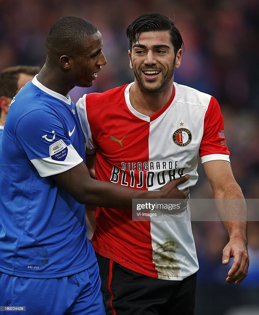 Douglas of FC Twente (L), Graziano Pelle of Feyenoord (R) during the Dutch Eredivise match between Feyenoord and FC Twente at stadium De Kuip on January 27, 2013 in Rotterdam, The Netherlands.