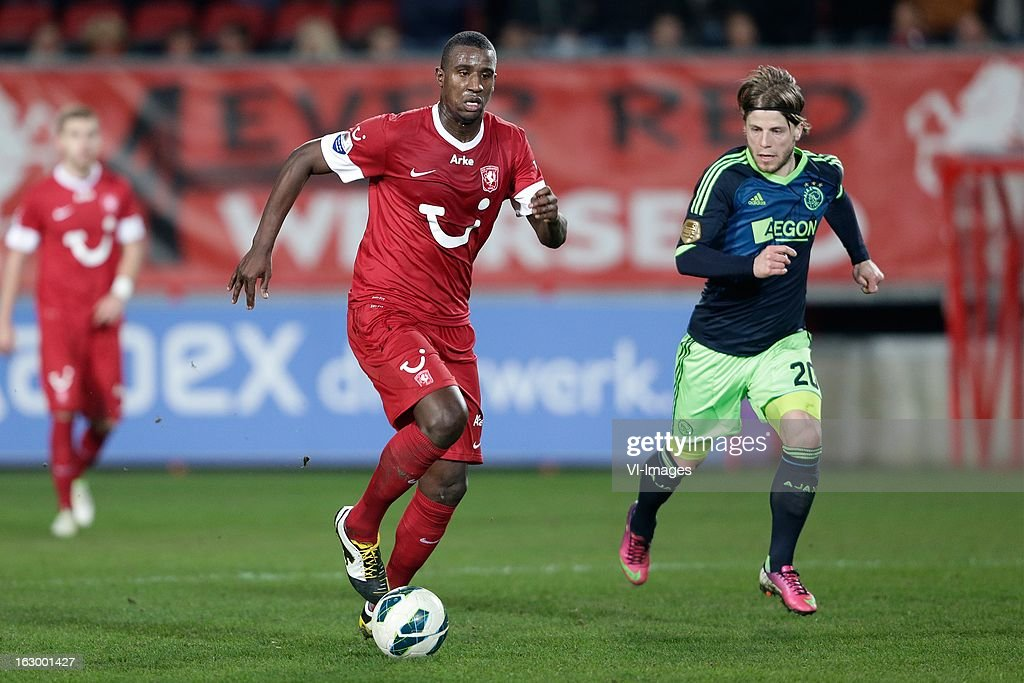 Douglas of FC Twente (L) Lasse Schone of Ajax (R) during the Dutch Eredivisie match between FC Twente and Ajax Amsterdam at the Grolsch Veste on march 02, 2013 in Enschede, The Netherlands