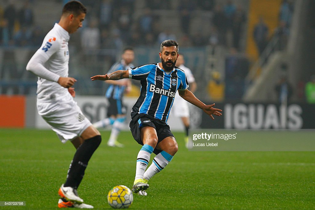 Douglas of Gremio battles for the ball against Gustavo Henrique of Santos during the match Gremio v Santos as part of Brasileirao Series A 2016, at Arena do Gremio on June 03, 2015 in Porto Alegre, Brazil.