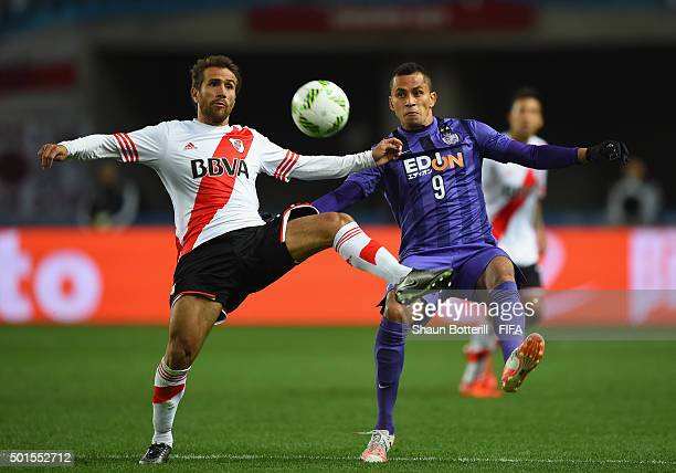 Douglas of Sanfrecce Hiroshima and Leonardo Ponzio of River Plate challenge for the ball during the FIFA Club World Cup semi final match between...