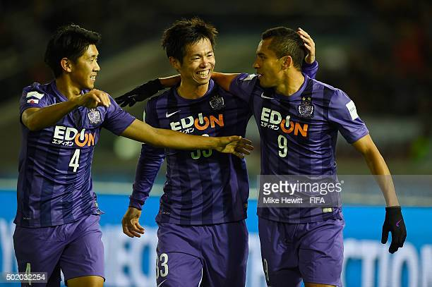 Douglas of Sanfrecce Hiroshima celebrates with team mate Hiroki Mizumoto andTsukasa Shiotani after scoring the winning goal during the FIFA Club...