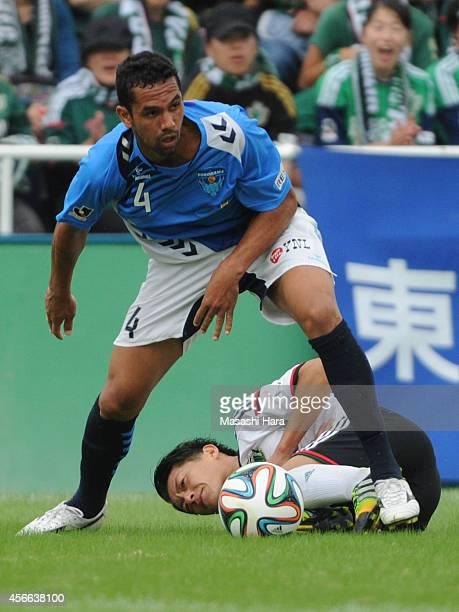 Douglas of Yokohama FC and Hayuma Tanaka of Matsumoto Yamaga compete for the ball during the JLeague second division match between Yokohama FC and...